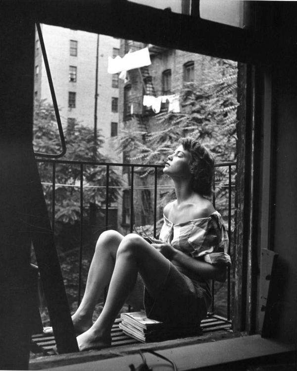 nina-leen-a-young-woman-napping-on-her-balcony-new-york-1950s-1366059397_b